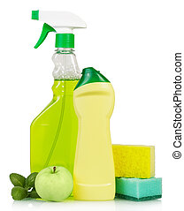 Cleaning products and green apple on white background