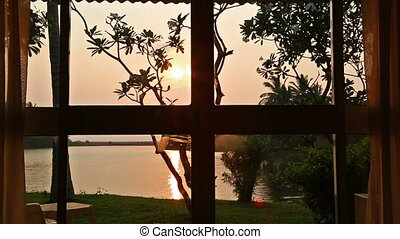 View from the room window on the lake and sunset