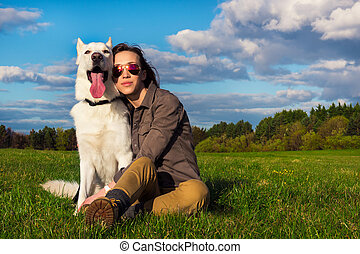 Young attractive girl with her pet dog