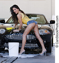 Brunette Model at the Car Wash - A brunette model washes her...