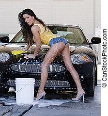 Brunette Model at the Car Wash - A brunette model washes her...