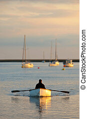 all the time in the world - relaxing in a row boat at sunset