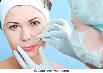 botox injection - Beautiful woman receiving a botox...