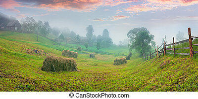 Haymaking in a Carpathian village. Colorful summer sunrise...