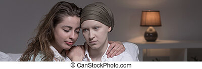Friend supporting cancer woman - Horizontal view of friend...