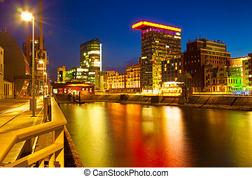 Colorful night scene of Rhein river at night in Dusseldorf....