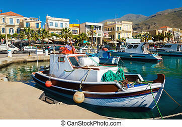 Colorful wooden boats in cosy Greek port - Colorful wooden...