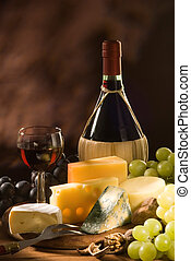 Cheese and Wine - Glass and bottle of red italian wine with...