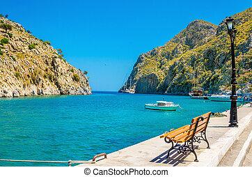Bench, isthmus sea in port of Vathi Greek Island - Amazing...