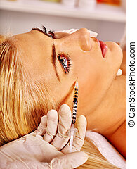 Doctor woman giving botox injections. - Doctor woman giving...