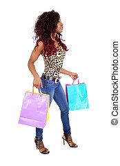 African woman going shopping - A lovely slim young African...