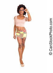Young girl in short skirt. - A pretty African American woman...