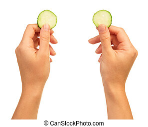 Hands with cucumber