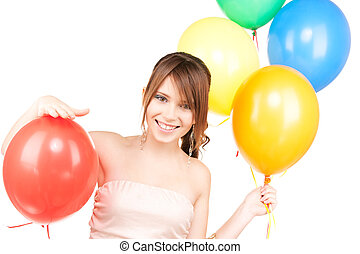 happy teenage girl with balloons over white