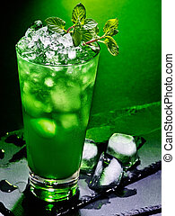 Green cocktail on dark background 43. - Green drink with...
