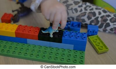 A young child plays in the constructor - Game of the...