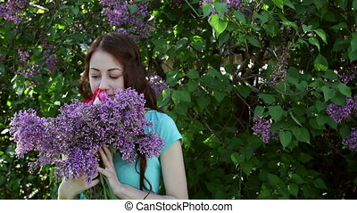 beautiful woman walking in spring park with a bouquet of...
