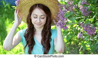 Beautiful young woman wearing straw