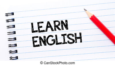 Learn English Text written on notebook page, red pencil on...