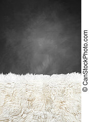 white fur carpet and dark grey painted wall , use for...