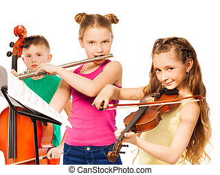 Group of children playing on musical instruments - Group of...