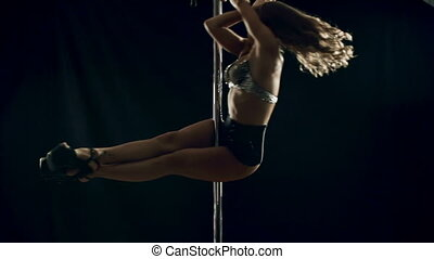 Pole Dancing - Pretty girl with muscular body pole dancing