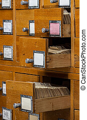 Open boxes in the old archive library card or file catalog