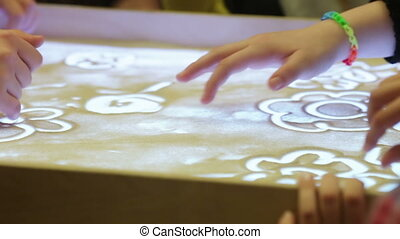 Education sand animation - Drawing with sand Swans, painted...