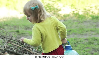 Child with an aunt picnic - Girl child in nature helps her...