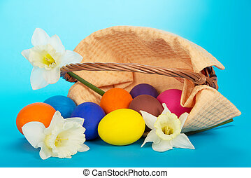 Eggs and white flowers - The overturned basket with eggs and...