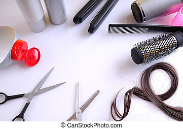 Set hairdressing articles around a white table top view -...