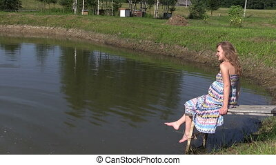 "woman girl fun near pond - ""pregnant woman play with..."