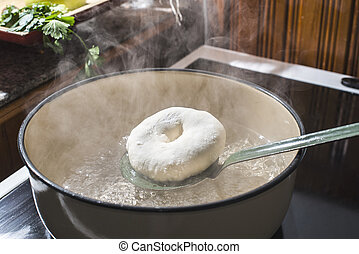 Cooking bagels in vintage saucepan