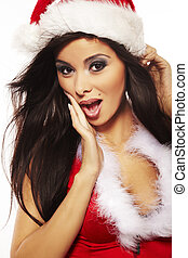 Portrait of beautiful brunette woman wearing sexy santa...