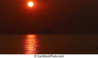 view of sunrise above sea against islands - panorama of...