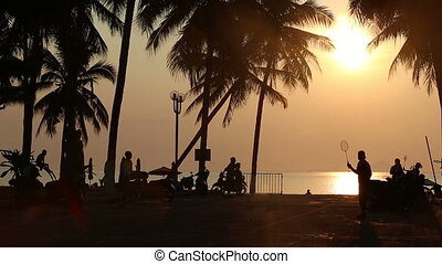 people play badminton on embankment at sunrise - NHA TRANG,...