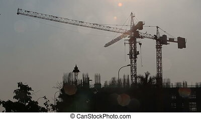 crane turns derrick over construction carriage moves - crane...