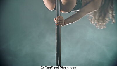 Pole Art - Fit sexy lady moving around the pole seductively