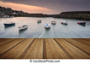 A traditional Cornish fishing village before sunrise in...