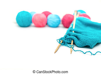 colorful yarn, knitted fabric and knitting spokes