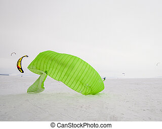 Kiteboarder with kite on the snow - Kite surfer being pulled...