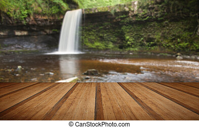 Beautiful woodland stream and waterfall in Summer with...