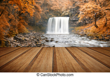 Beautiful woodland stream and waterfall in Autumn Fall with...