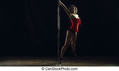 Round the Pole - Slow motion of professional pole dancer...