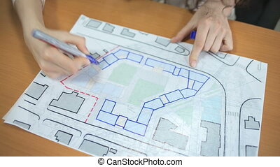 Girl draws marker plan residential