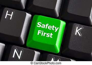 safety first concept with green key on computer keyboard