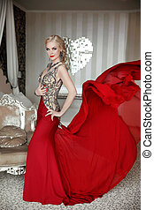 Attractive blond woman model wearing in elegant dress with...