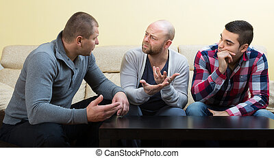 Guys sharing problems at the table - Three male friends...