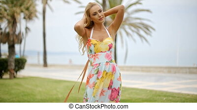 Woman in Sun Dress at Ocean Front Promenade - Blond Woman...
