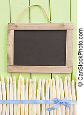 Fresh white asparagus on rustic wooden boards